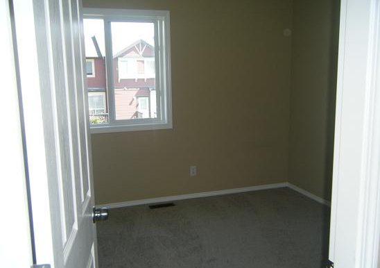 209 Luxstone Rd SW Bedroom 1